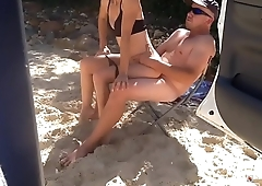 Beach babe sucks and fucks strangers hard cock on the beach #4