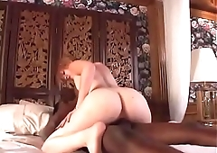 Enchanting redhead with small tits  enjoys a sweaty interracial sex shoot