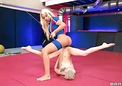 Wrestling match of two blondes ends with lesbian sex