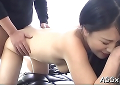 Cute oriental receives raucous toying for her slit and anal