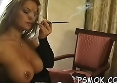Wild women enjoyable each other while smoking