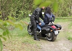 Muscled Biker Stretches Brunette'_s pussy outdoors